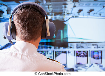 Airline pilot wearing uniform with epaulettes and headset...