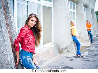 Three happy friends wearing jeans