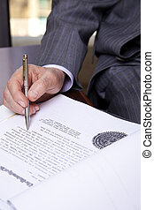 Senior About to Sign - Close up on hands of a senior in his...