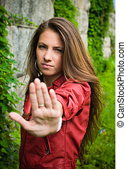 Young girl showing stop sign - Young womanl showing stop...