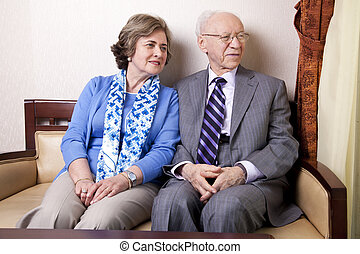 Elderly Couple Looking Away - A high society senior couple...