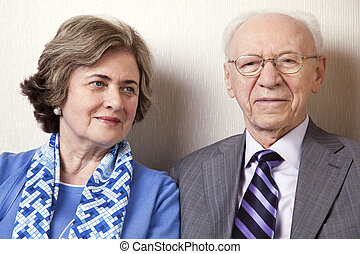Elderly Couple Close Up - A high society senior couple hes...