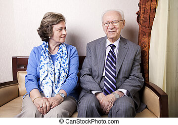 Elderly Couple - A high society senior couple hes in his...