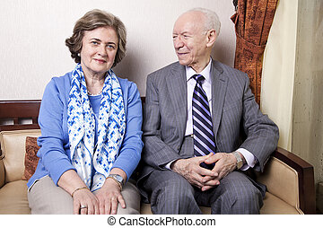 Happy Elderly Couple - A high society senior couple (he's in...