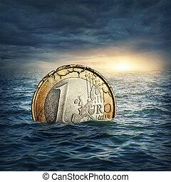 Euro crisis concept - Euro coin sinking in water. Euro...