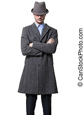 Anonymous Tough Guy - A person dressed in a gray overcoat...