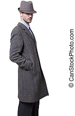 Handsome Tough Guy - A person dressed in a gray overcoat and...