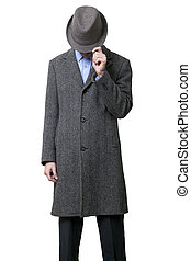 Hidden Fella - A young adult male wearing a gray overcoat...