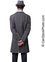 Rear View Elegant Man - A person dressed in a gray overcoat...