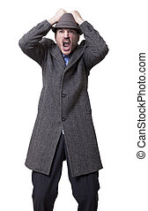 Frustration Inc - A young adult male wearing a gray overcoat...