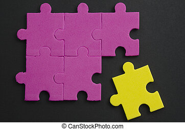 Tolerance - Textured puzzle pieces of different colors,...