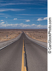 Open highway in New Mexico - Open deserted HWY 82 between...