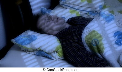 man sleep snore - A man is sleeping and snoring, choking it...