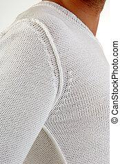 sweater on man shoulder
