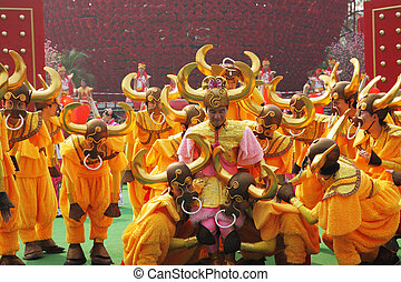 The ensemble in dazzling costumes - Chinese New Year. Speech...