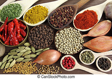 Spices and herbs in metal bowls and wooden spoons Food and...