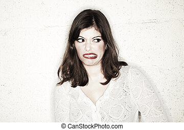 Disgusted Snub - Portrait of a beautiful young woman looking...