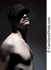 Anonymous Topless Mustache Man - Studio shot of an adult man...