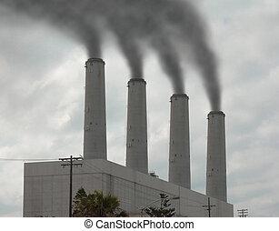 smoke stacks pouring smoke into the sky