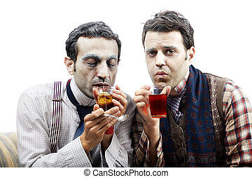 Wannabe Seniors Sipping Some Tea - Two adult man (mid 30's...