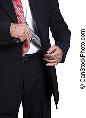 Taking Out the Gun - A mature adult man wearing a suit,...