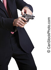 About to Shoot - A mature adult man wearing a suit, cocking...