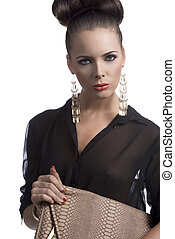 fashion brunette with bag in front of the camera