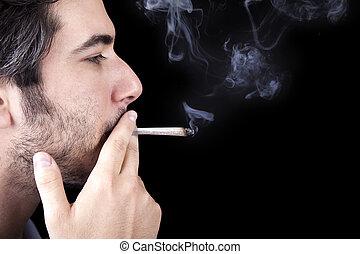 Adult Bum Smoking a Spliff - Closeup of an adult man (30...