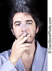 Adult Bum Smoking a Spliff - Medium closeup of an adult man...