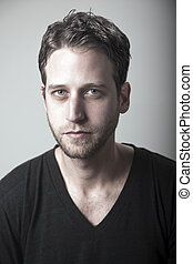 Seriously Handsome - Studio portrait of a caucasian adult...