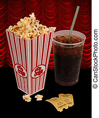 popcorn and movie - Popcorn, soda, tickets isolated on black...