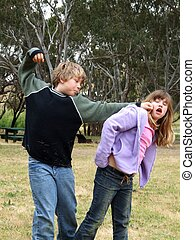 Schoolyard Bully - A boy bullying a girl