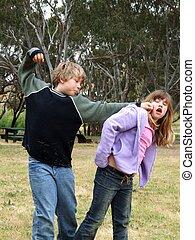 Schoolyard Bully - A boy bullying a girl