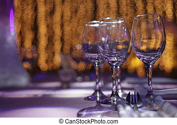 Banquet Setting - Three wine glasses set on a dinner table...