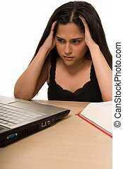 Student tired of studying - Young Hispanic woman sitting in...