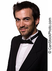 Handsome man in tuxedo - Attractive young brunette man with...