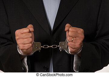 Handcuffed man - Male fisted hands up close in hand cuffs
