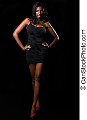 Woman in black dress - Full body of African American woman...