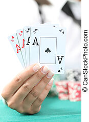 femal hand hold the four aces