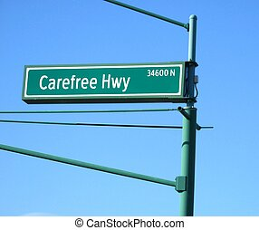 carefree highway sign against a blue sky