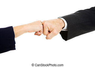 Business Fist Bump - Female and male business people giving...