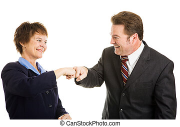 Business Partners Fist Bump - Happy business partners giving...