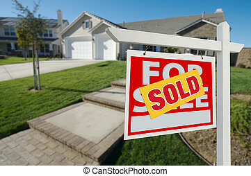 Sold Home For Sale Sign and House