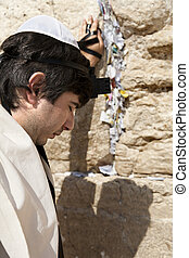 Jewish Man Praying at the Western Wall - A Jewish adult...