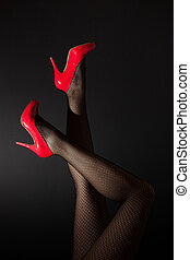 Head over high heels - A pair of sex legs in red high heels...