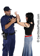 Handcuffing a ciminal - A male security officer handcuffs a...