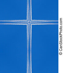 kaleidoscope cross:  jet contrails against blue sky