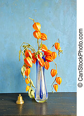 glass vase with dry husk tomato flowers and bell - glass...