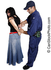 An officer apprehending a female - A security officer...