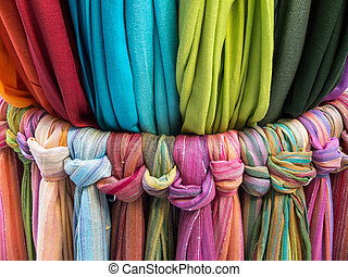 The scarf - Colorful scarfs on a market stall